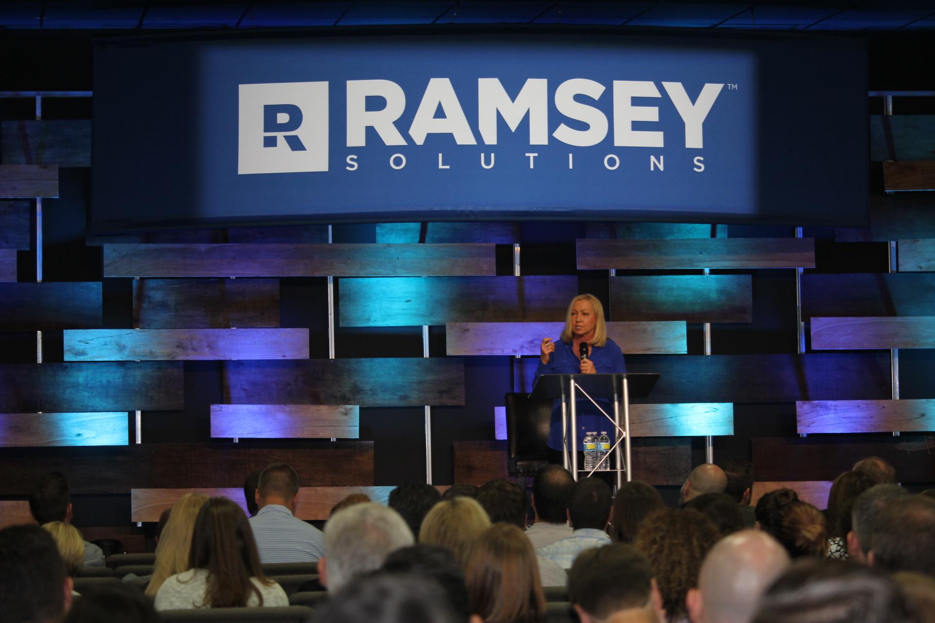 Nancy Alcorn addressing Ramsey Solutions staff
