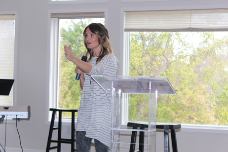 Pastor Andi Andrew preaching in Mercy's Nashville home