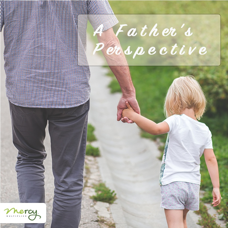 A Father's Perspective - Dad holding child's hand