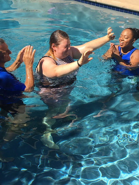 Mercy resident celebrates with Pastor Anfuso and Fredrica Singletary during her baptism
