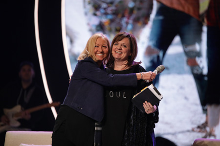 Nancy giving Debbie a heartfelt hug of thanks