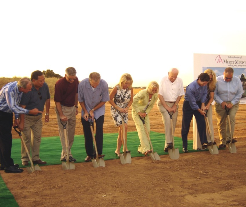 Nancy Alcorn breaking ground on a Mercy Multiplied development