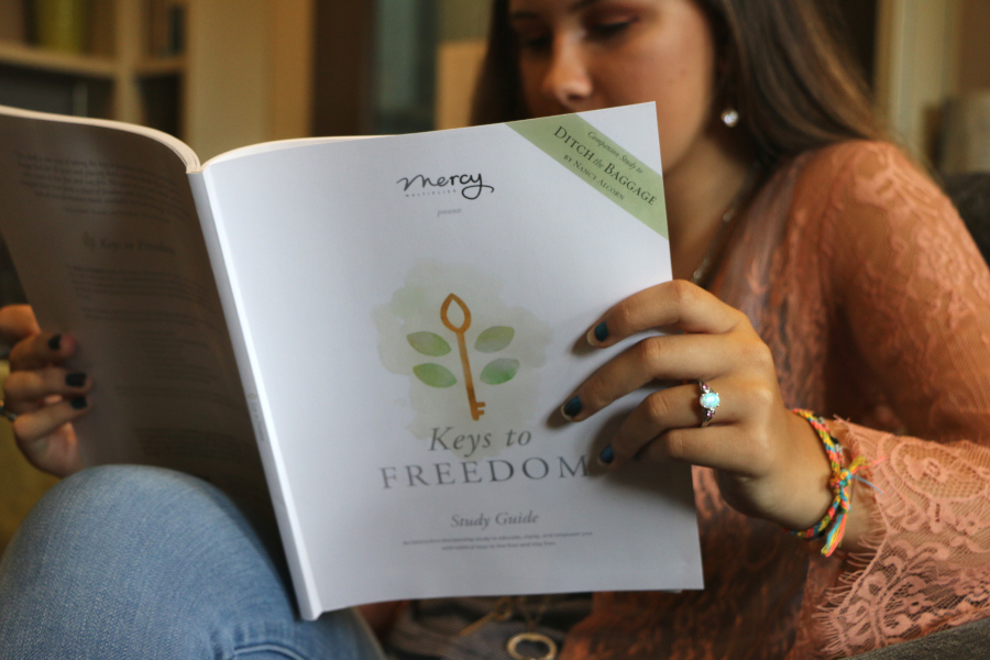Woman reading the Keys to Freedom study guide
